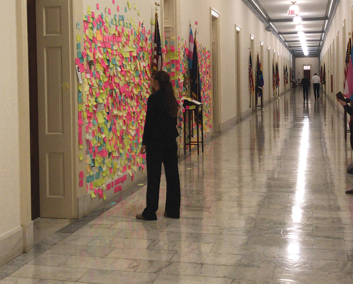 Post it notes on wall of Capitol Hill, Washington, D.C.