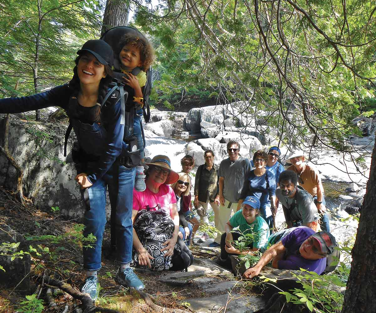 Visitors enjoy a guided hike to Tobey Falls
